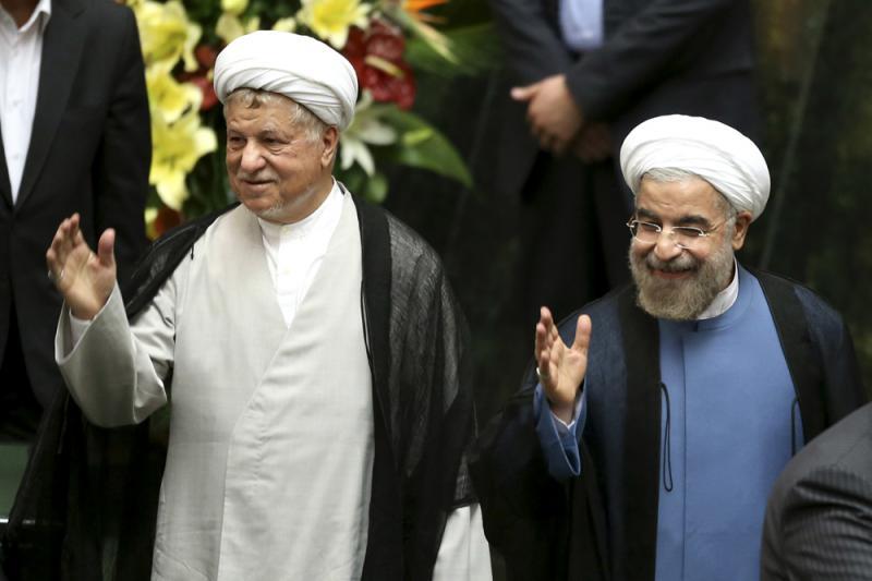 图:伊朗前总统拉夫桑贾尼(左)和伊朗现任总统鲁哈尼 /美联社-伊朗