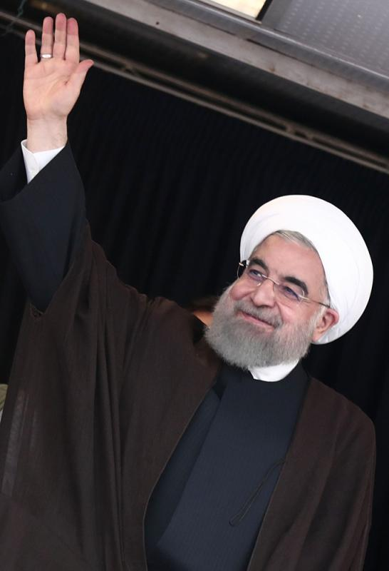 图:伊朗现任总统、大选候选人鲁哈尼/法新社-伊朗今大选 鲁哈尼内外