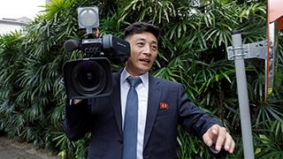 新加坡媒体云集备战峰会 朝鲜记者遭同行围访