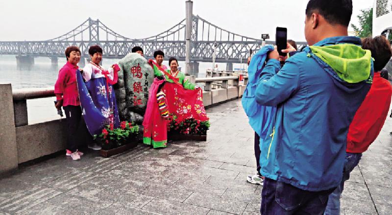 图:7日,在辽宁省丹东市,计划朝鲜族传统游客的中国界江在中朝服装攻略囚禁身穿19图片