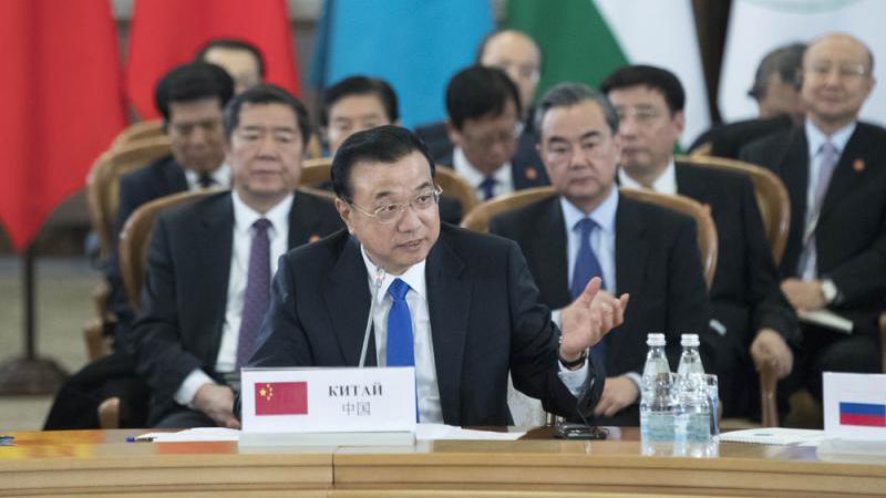 李克强亚欧行倡建开放型经济 齐发声共护多边贸易