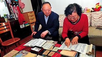 青岛夫妇20本帐簿见证改革开放40年巨变 工资增长141倍