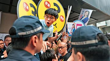 黄之锋带队冲击推撞陈凯欣 高永文:若谈民主应互相尊重