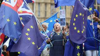 """英国首相府:""""脱欧""""议案投票明年1月21日前举行"""