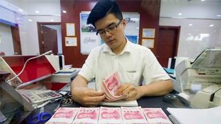 中国去年人民币贷款增16.17万亿元 房地产贷款增速回落