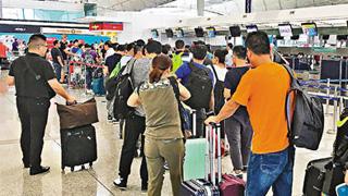 港机场启动传染病防控机制 设防疫站接种麻疹疫苗