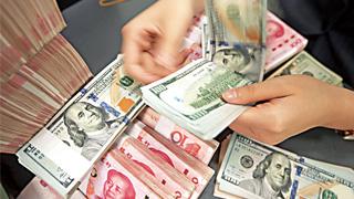 人民币对美元汇率中间价报7.0211元 下调75个基点