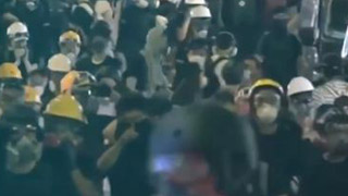 "rap歌劝港青勿做""迷徒"":雨伞头盔给不了你未来"