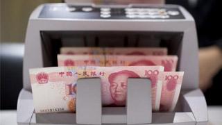"""央行:目前人民币汇率预期平稳 印证""""7""""不是堤坝"""