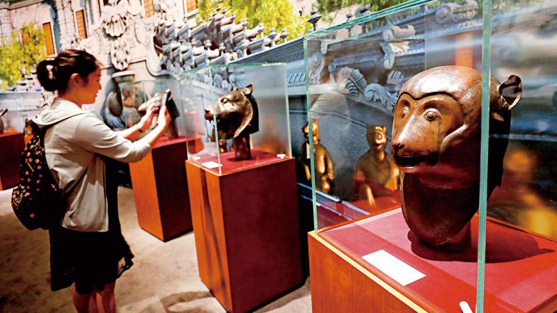 圆明园兽首铜像重聚 六百余件文物讲述归国故事