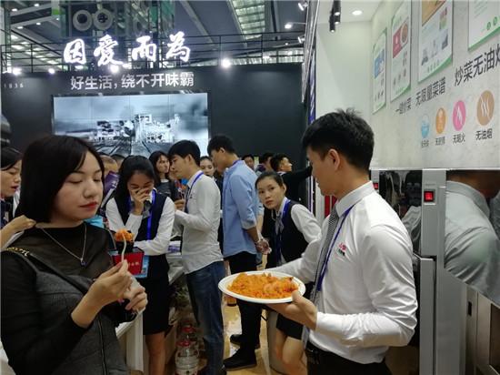 高交会中国企业高技术加快出口步伐 绿色节能电机和炒菜机器人受青睐