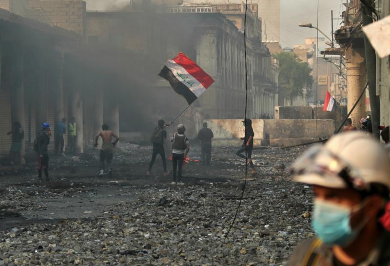 伊拉克乱局持续 暴徒圣城纵火