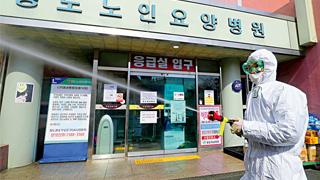 韩国新冠肺炎确诊病例破万 正全力应对海外输入