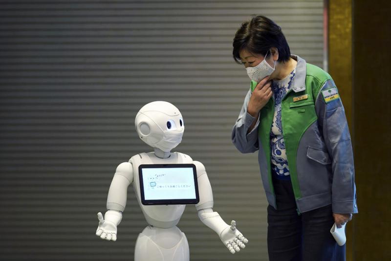 """?""""我為你加油!"""" 東京出動機械人安撫病人"""