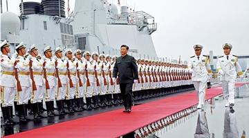?政治局:政治工作贯穿军事战斗力建设