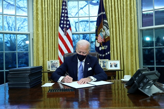 Biden signed a number of executive orders, including a return to the Paris climate agreement