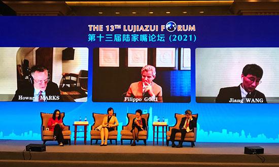 中国进出口银行董事长胡晓炼:本世纪中叶人民币或成全球可信赖国际货币